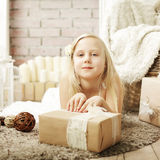 Cute little girl with gift Stock Photos