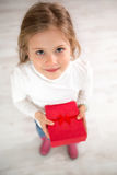 Cute little girl with gift Royalty Free Stock Images