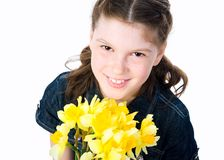 Cute little girl giving flowers Stock Photography