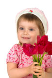 Cute little girl giving pink tulips Royalty Free Stock Images
