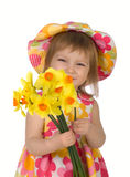 Cute little girl giving yellow flowers Stock Image