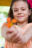 Cute little girl giving you the flower Royalty Free Stock Photos