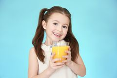Cute little girl with glass of juice Royalty Free Stock Photos