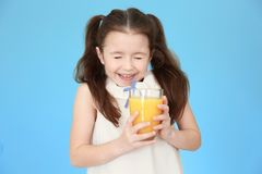 Cute little girl with glass of juice Stock Image