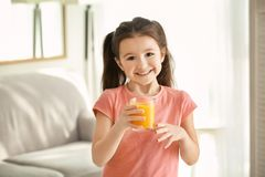Cute little girl with glass of juice Stock Photo