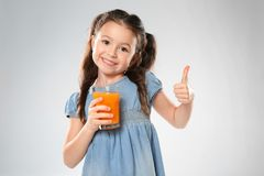 Cute little girl with glass of juice Stock Photos