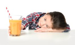 Cute little girl with glass of juice Stock Photography