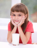 Cute little girl with a glass of milk Stock Photo