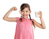 Cute little girl with glass of milk. On white background royalty free stock photos