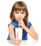 Cute little girl with a glass of milk Royalty Free Stock Photo