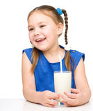 Cute little girl with a glass of milk Stock Photos