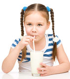 Cute little girl with a glass of milk Royalty Free Stock Photography
