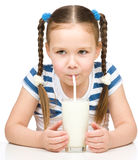 Cute little girl with a glass of milk Stock Photography