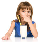 Cute little girl with a glass of milk Royalty Free Stock Photos