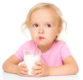 Cute little girl with a glass of milk Royalty Free Stock Images