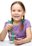 Cute little girl with a glass of water Stock Photography
