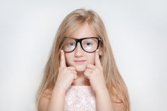 Cute little girl with glasses. Cute kid with glasses posing very well Royalty Free Stock Image
