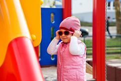 Cute little girl with glasses on playground Stock Photos