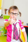 Cute little girl in glasses showing thumb up Royalty Free Stock Image