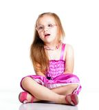 Cute little girl glasses sitting on floor isolated Stock Images