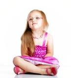 Cute little girl glasses sitting on floor  Stock Photo