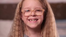 Cute little girl in glasses smiling stock video