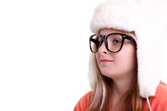 Cute little girl with glasses in warm white hat Royalty Free Stock Photo