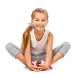 Cute little girl goes in for sports Royalty Free Stock Photos