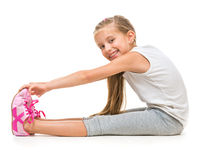 Cute little girl goes in for sports Stock Photos