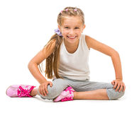 Cute little girl goes in for sports Royalty Free Stock Image