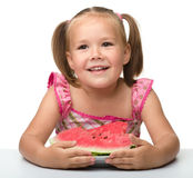 Cute little girl is going to eat watermelon Royalty Free Stock Photo