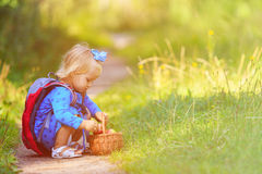 Cute little girl going to forest picnic Royalty Free Stock Photos