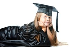 Cute little girl in graduation dress on isolated w Stock Image