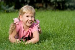 Cute little girl in grass. Royalty Free Stock Photography