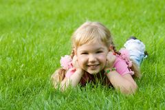 Cute little girl in grass. Royalty Free Stock Images
