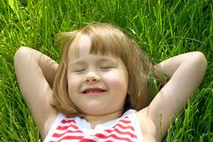 Cute little girl in grass Stock Photos