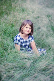Cute little girl in grass royalty free stock photos