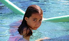 Little girl green eyes children playing at pool at tropical resort in Los Cabos Mexico. Cute Little girl green eyes children playing at pool at tropical resort Stock Images