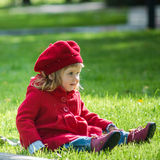Cute little girl on the green grass Stock Photography