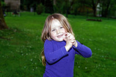 Cute little girl on green grass background Stock Image