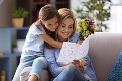 Cute little girl greeting her mother at home Royalty Free Stock Image