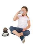 Cute little girl and grey kitten both drinking milk Stock Photography