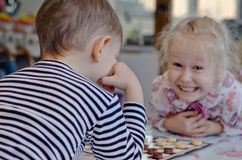 Cute little girl grinning at her brother Royalty Free Stock Photography