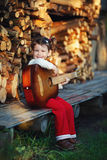 Cute little girl with guitar Royalty Free Stock Photos