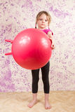 Cute little girl with gymnastic ball Stock Image
