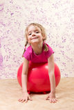 Cute little girl with gymnastic ball Royalty Free Stock Image
