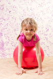 Cute little girl with gymnastic ball Stock Images