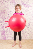 Cute little girl with gymnastic ball Royalty Free Stock Photography