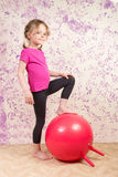 Cute little girl with gymnastic ball Royalty Free Stock Photo