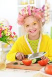 Portrait of cute little girl with hair curlers stock photography
